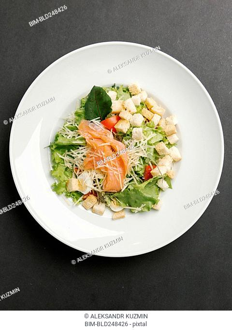 Seafood salad with cheese and croutons