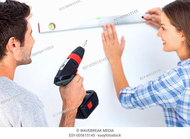 Woman and her husband measuring together