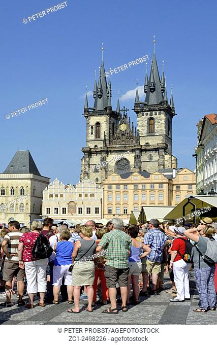 Prague, Czech Republic - July 07, 2015: Group of Tourists at the Old Town Square in front of the Church of Our Lady before Tyn of Prague in the Czech Republic