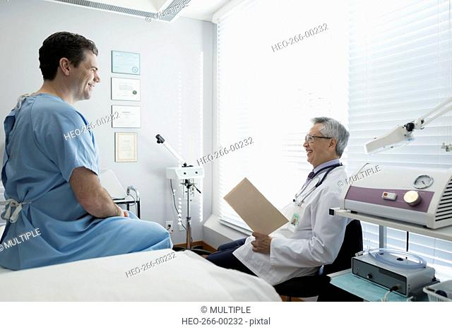 Doctor reviewing medical record with patient examination room