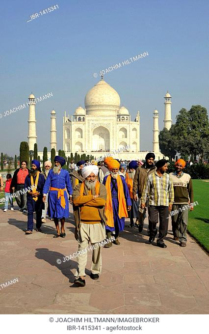A group of Sikhs in front of the Taj Mahal, UNESCO World Heritage Site, Agra, Uttar Pradesh, North India, India, South Asia, Asia