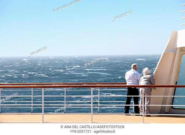 Retired couple on the deck of a cruise ship