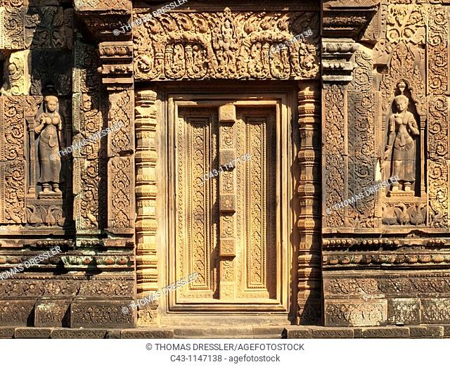 Cambodia - Niches with Devatas deity, divinity at the south Library at the temple of Banteay Srei, which is known for the exquisite exuberance of its sandstone...