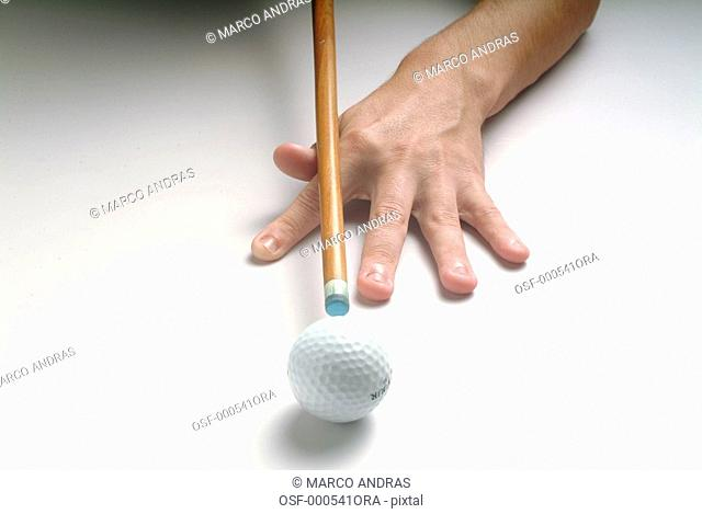 a person palying snooker with a golf ball