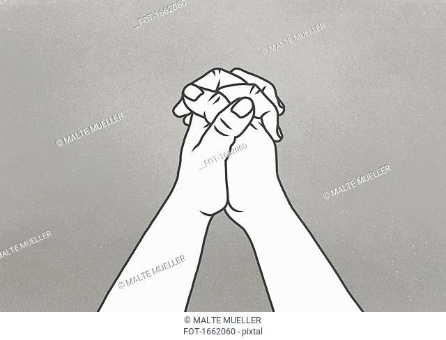 Cropped image of clasped hands against gray background