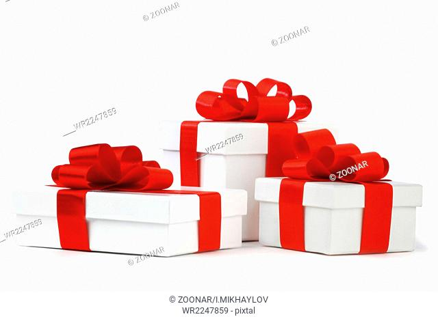 White gift boxes with red ribbon bows