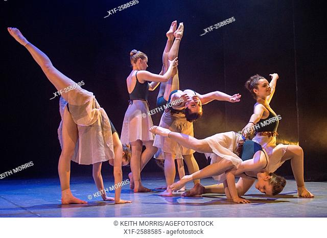 A group of young teenage girl student ballet dancers at Aberystwyth Arts Centre Dance School dancing on stage in an adaptation of JM Barrie's Peter Pan
