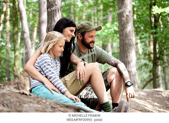 Happy family with daughter in forest