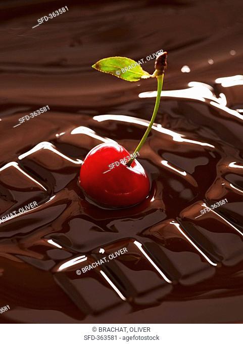 Cherry in melting chocolate