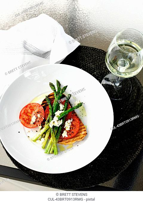 Plate of bread, tomato and asparagus