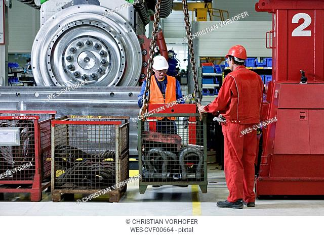 Industry, workers and indoor crane