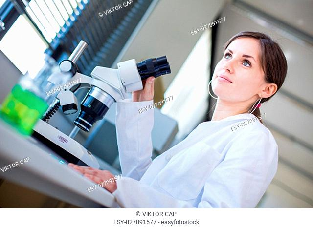 Portrait of a female chemistry student carrying out research in a chemistry lab (color toned image; shallow DOF)