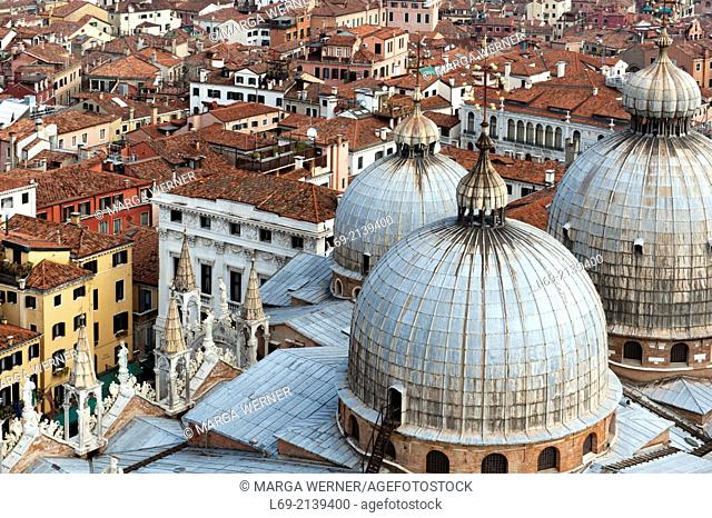 View on Venice from above with domes of Saint Mark's Basilica, Veneto, Italy