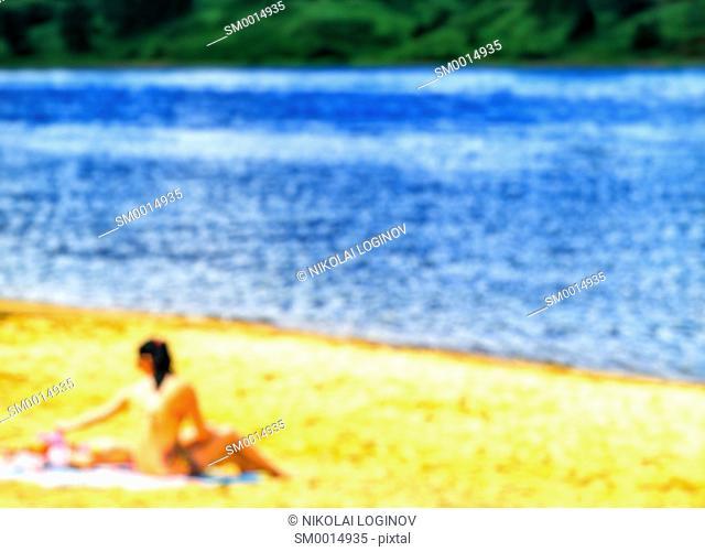 Girl on the beach composition bokeh