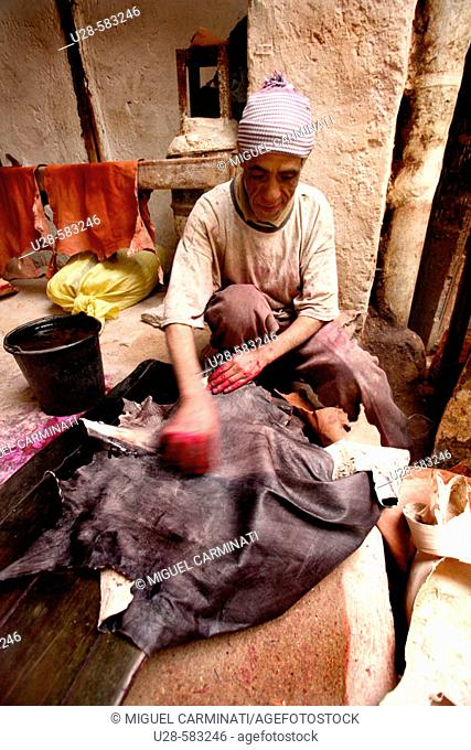 Man working in a tannery. Marrakech, Morocco