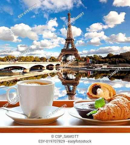 Coffee with croissants against Eiffel Tower in Paris, France