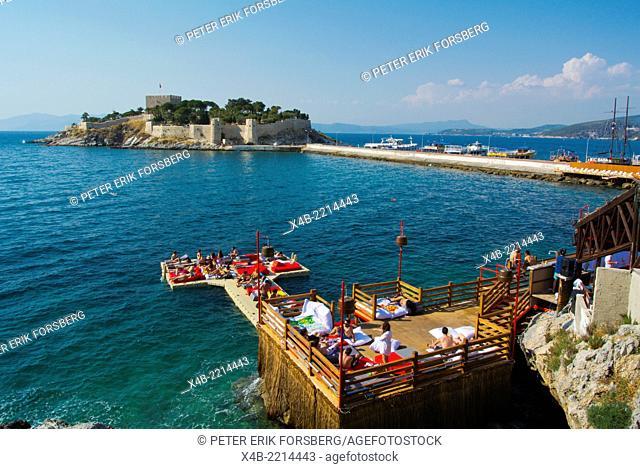 Beach club bar pier with a view towards Pigeon Island, Kusadasi, Turkey, Asia Minor