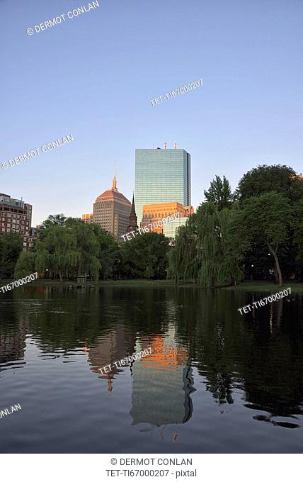 Copley Square reflecting in Boston public Garden pond