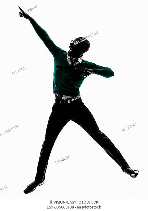 one african black man jumping happy in silhouette studio on white background