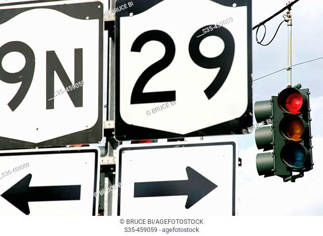 Highway direction signs and traffic light in New York, USA