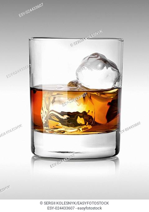 Alcohol beverage with ice isolated on white