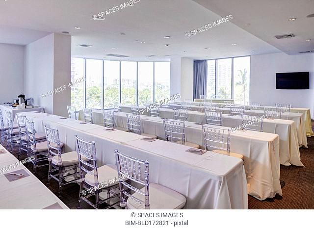 Empty tables in banquet hall