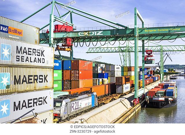 container terminal, containers are being loaded onto a freight train and a container barge ,inland harbor, stuttgart, baden-wuerttemberg, germany