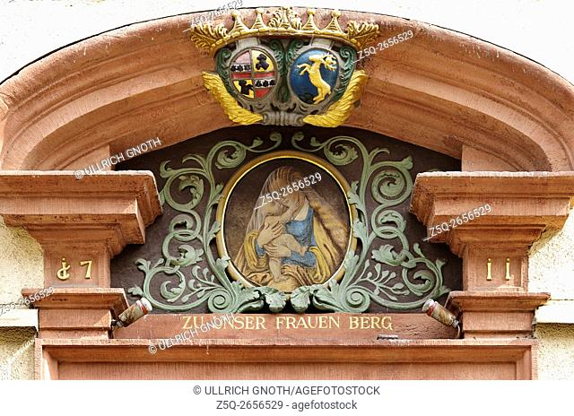 Vision of Mary and little Child Jesus on a pediment above the doorway of Rathausgasse Nr. 15 street, Freiburg, Black Forest, Germany