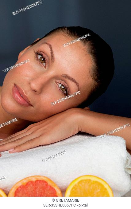 Woman resting her head on towel