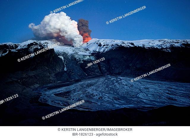 Ash cloud of the Eyjafjallajoekull volcano, steam plume from the lava flow in Gigjoekull glacier tongue, and exit point of the previous flood, Gigjoekull