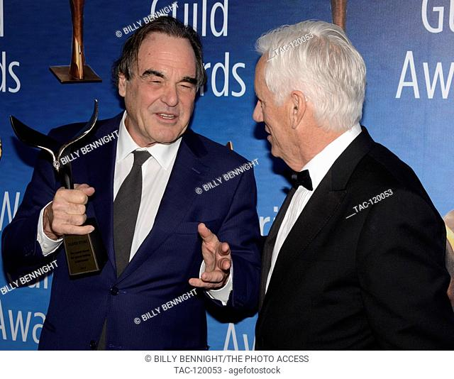Screenwriter/Director Oliver Stone and actor James Woods pose with the Laurel Award for Screenwriting Achievement during the 2017 Writers Guild Awards L