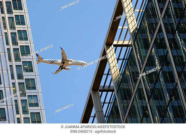 Airplain over Canary Wharf in Final Approach to the Airport, London, United Kingdom, Europe
