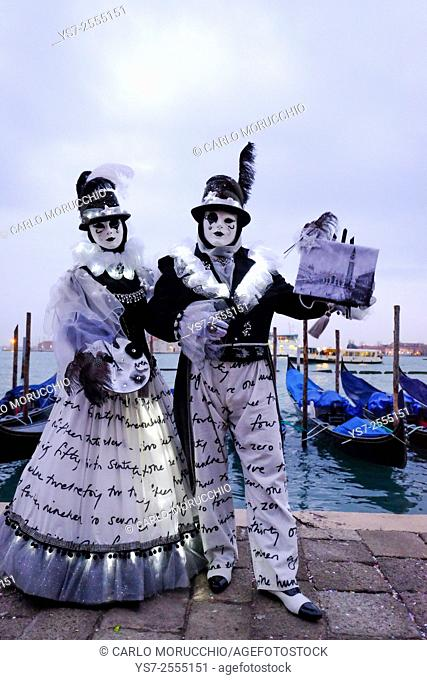 Masks and costumes at St. Mark's square during Venice Carnival, Venice, Italy, Europe