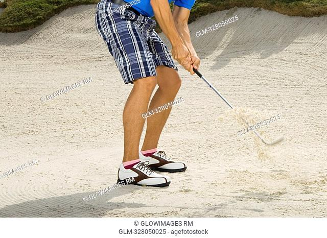 Low section view of a man playing golf, Biltmore Golf Course, Coral Gables, Florida, USA