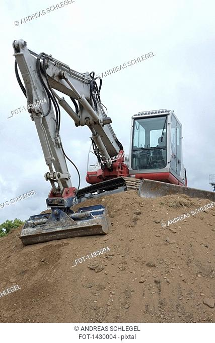 Low angle view of excavator at construction site