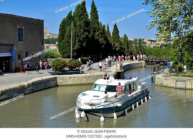 France, Herault, Beziers, Canal du Midi listed as World Heritage by UNESCO, yacht at the exit of the upper airlock upstream to the locks of Fonseranes