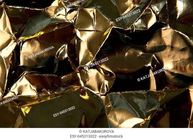 texture of crumpled golden foil