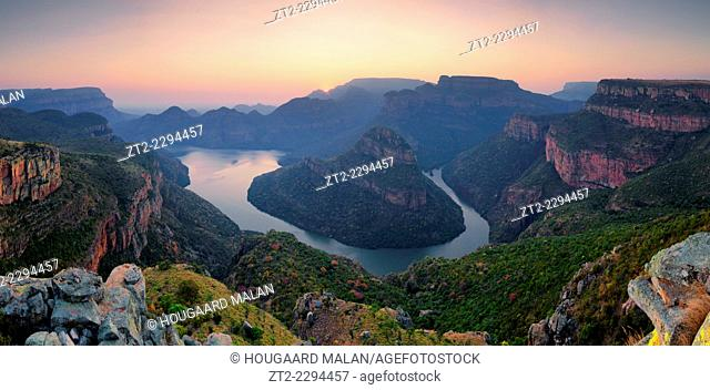 Landscape photo of a hazy winter sunrise over Blyde River Canyon. Mpumlanga, South Africa