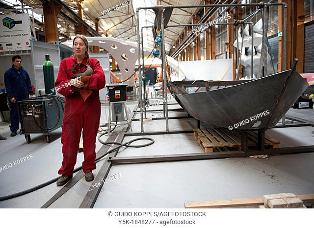 Rotterdam, Netherlands. A female tech student presents her work, a self welded boat or sloop