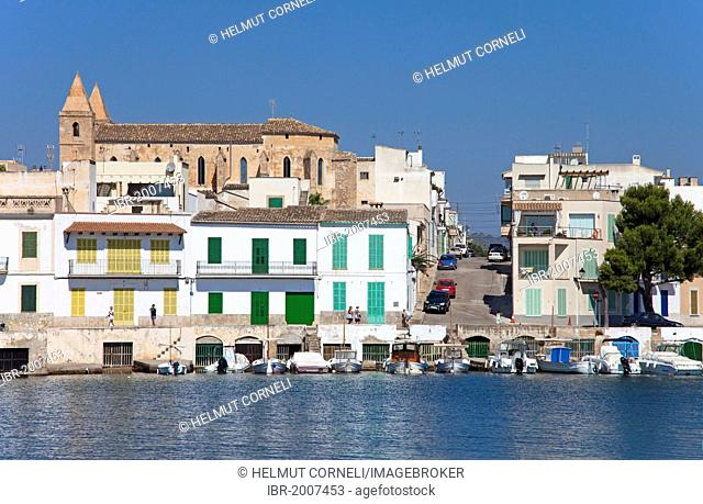 Fishermen's houses with boathouses underneath, church, harbour, Porto Colom, Felanitx, Majorca, Balearic islands, Spain, Mediterranean Sea, Europe