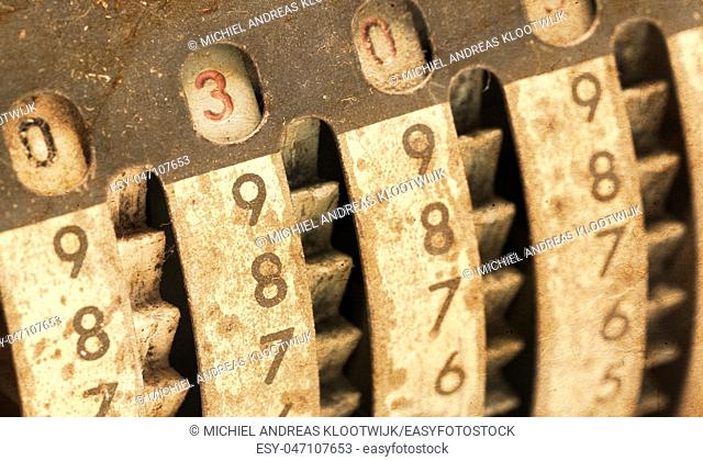 Vintage manual adding machine isolated on white, selective focus - 300