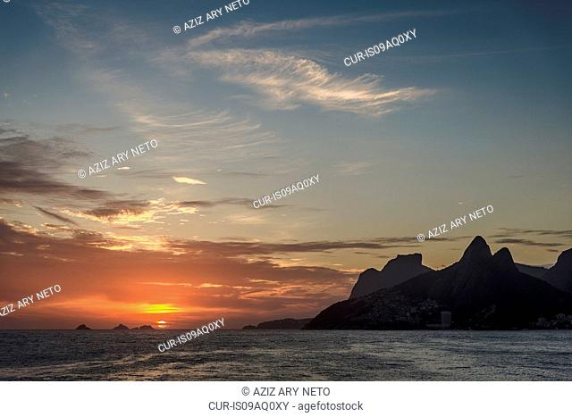 View of sea and mountains at sunset, Rio De Janeiro, Brazil