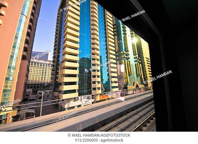 Modern buildings view through Dubai Metro Window