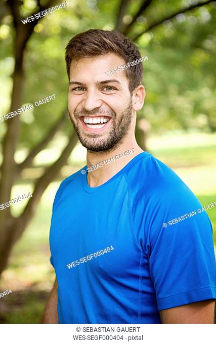 Portrait of sportive man in a park