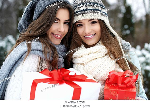 Lovely girls with Christmas gifts. Debica, Poland