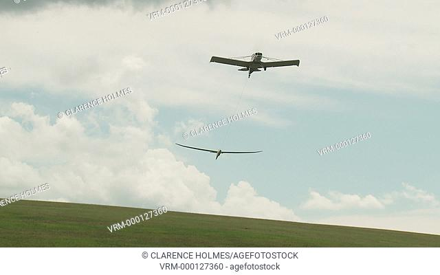 ELMIRA, NY - AUGUST 2: Peter Scarpelli's Discus 2b sailplane is launched via aerotow during the 2013 SSA Region 3 Soaring contest at Harris Hill gliderport on...