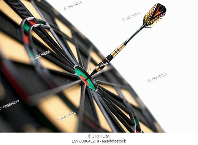 red dart on bullseye