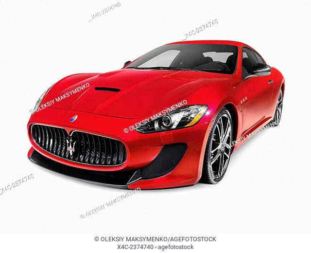 2015 Red Maserati GranTurismo MC Centennial Edition luxury car. Isolated on white background with clipping path