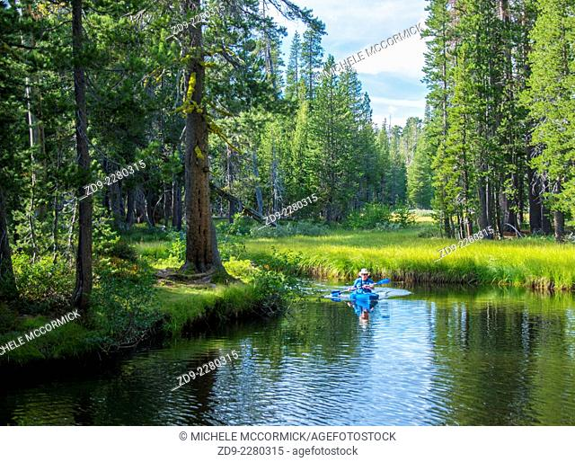A cool reflective stream is a kayakers paradise in California's high Sierra
