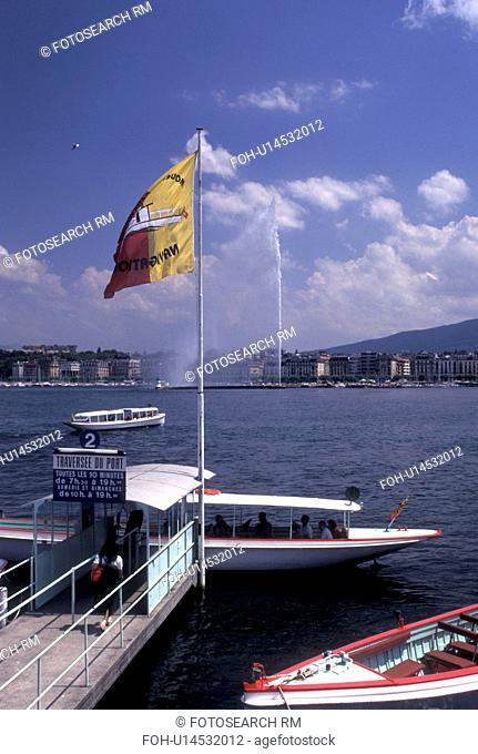water taxi, Geneva, Switzerland, Lake Geneva, Water taxi loading passengers at the dock on Lac Leman in Geneva. View of Jet d' Eau in the background